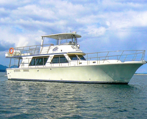 Side view of 53 foot luxury motor yacht at anchor