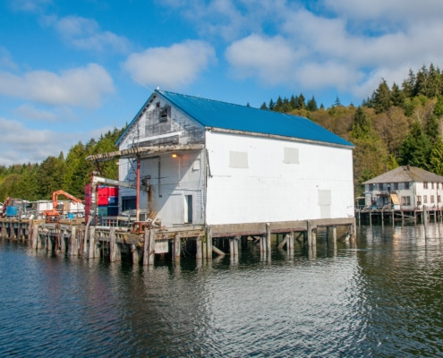 Old wooden building, Bornstein's fish delivery plant, built on wooden pilings over the ocean.