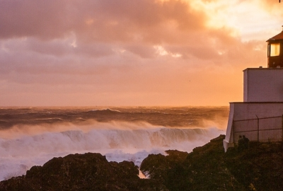 View of Amphitrite lighthouse in Ucluelet, BC, at sunset